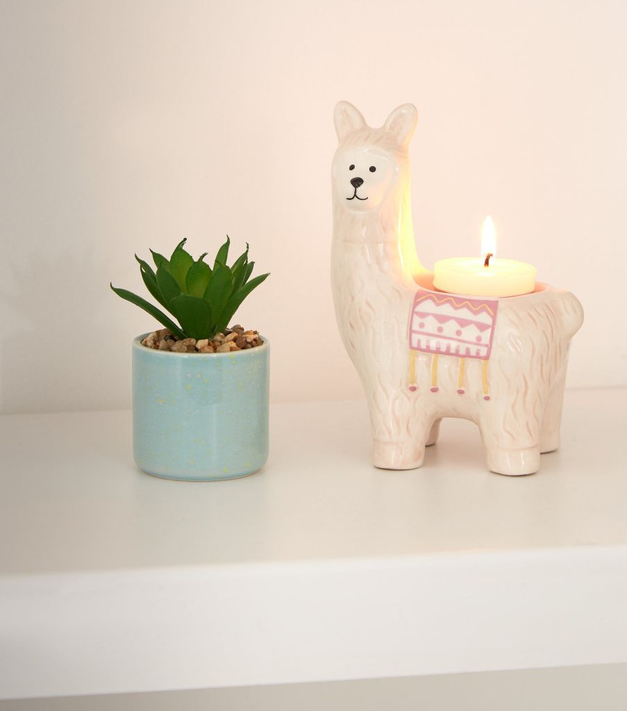 Who doesn't love a llama? This cute piece is designed as a tealight candle holder and is a fun and decorative accessory for your home