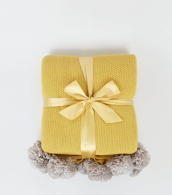 Every home needs at least one throw - and this yellow one is a fab colour!