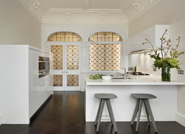 Family friendly white kitchen design with breakfast bar seating