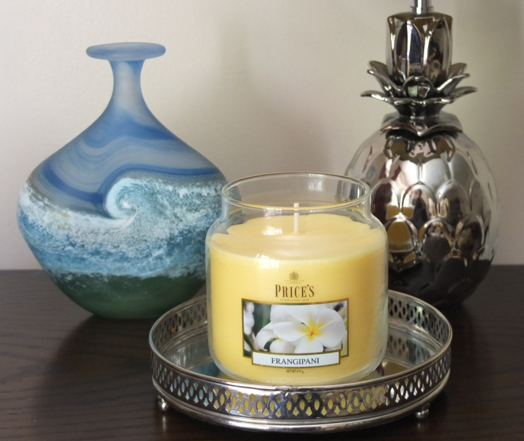 Unleash the exotic scent of frangipani flowers with Price's Candles