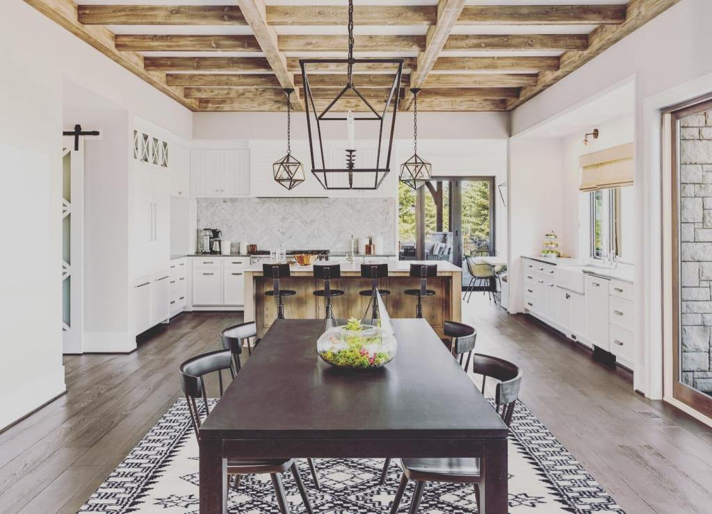 The large handmade rug helps define the dining area
