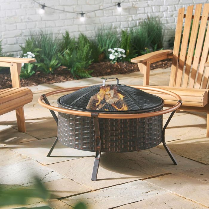 Copper rim fire pit that doubles up as a barbecue grill