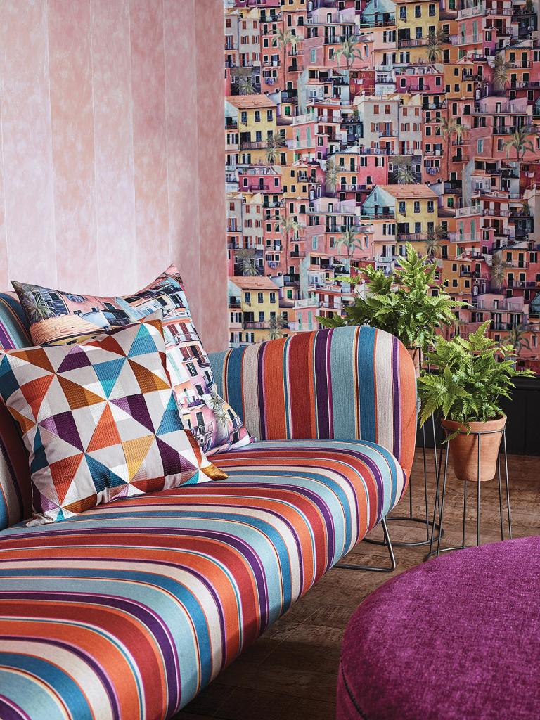 Here's a great example of how a busy wallpaper design can blend in wonderfully in interior design