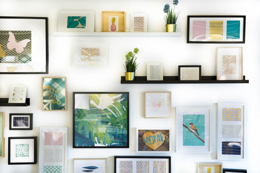 Use your creative skills to put together your own wall art gallery at home