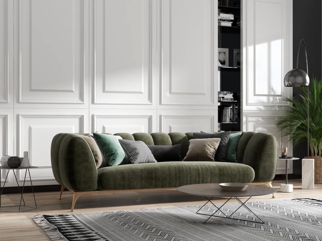 Luxurious dark green velvet sofa in a living room