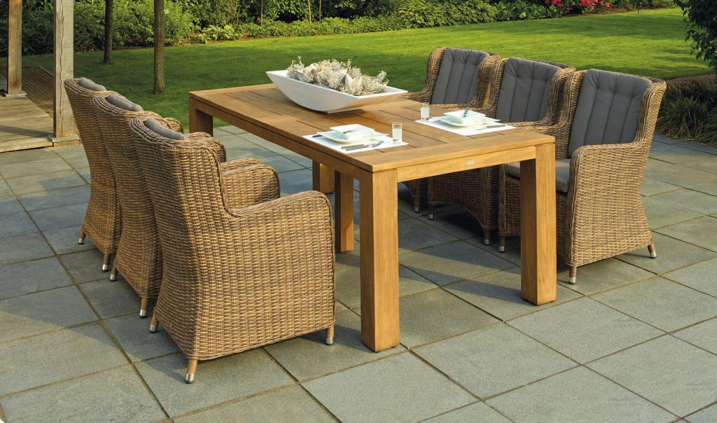 Outdoor garden table for four with wicker style chairs