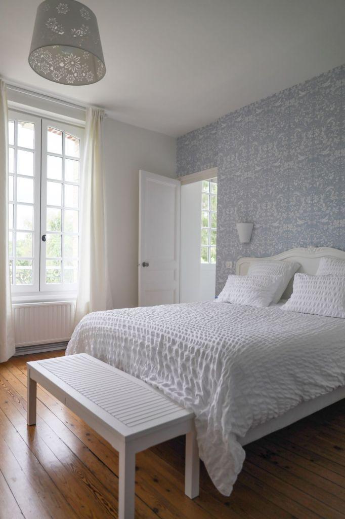 Vintage inspired wallpaper in a contemporary bedroom interior