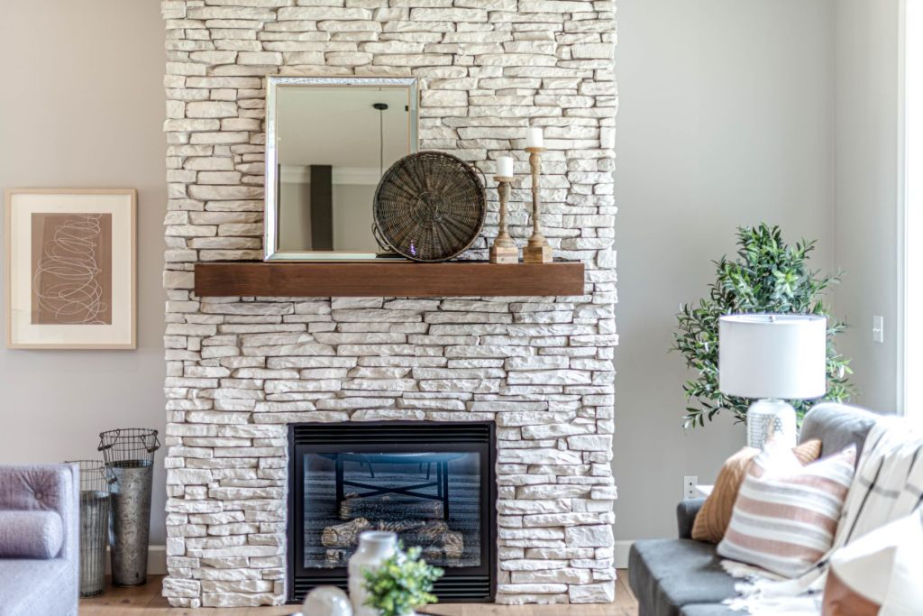 Stunning brick fireplace makes a centrepiece in a living room