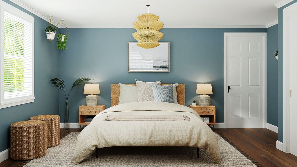 Bedroom decorated with blue walls and a large statement bed