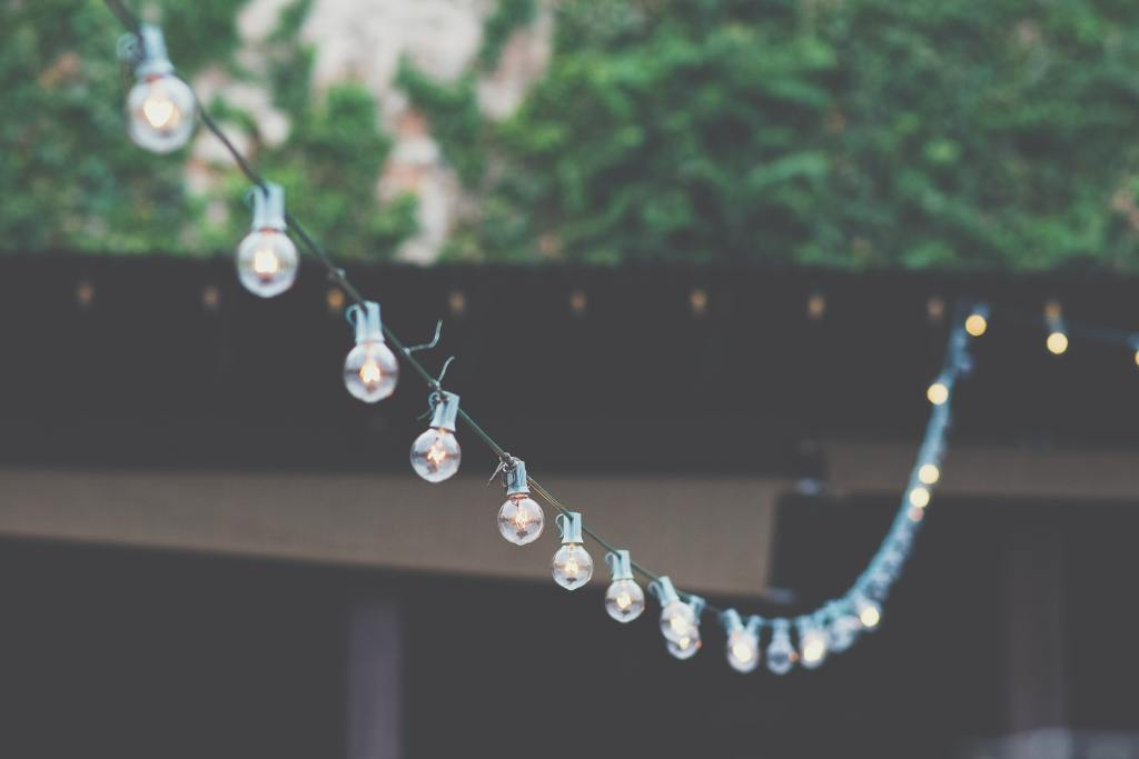 String fairy lights in your garden to create atmosphere at an outdoor party