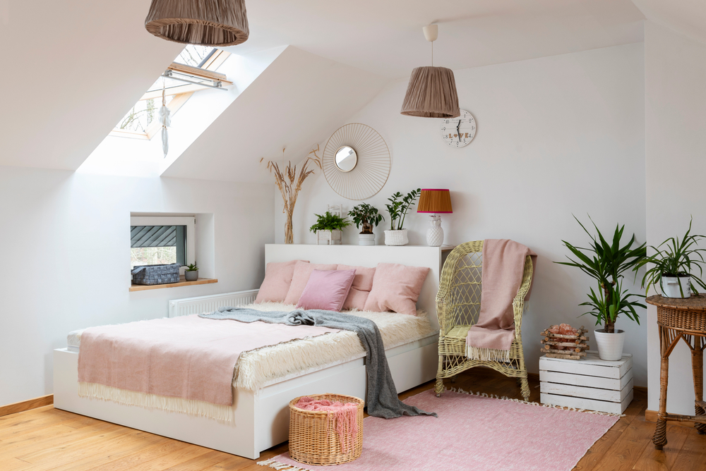 Pink and green teenage bedroom in an attic conversion