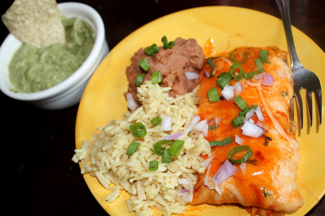 homemade shredded chicken enchiladas  with chicken rice, refried beans and guacamole ethnic mexican recipes
