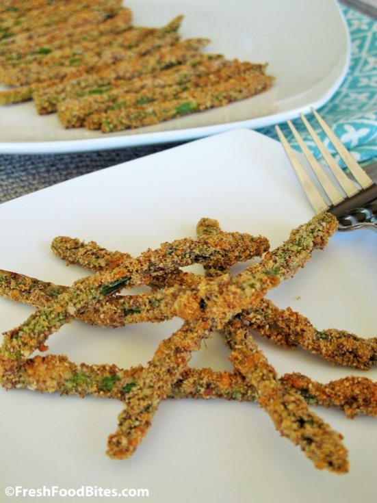 Fun and flavorful, this Baked Parmesan Crusted Asparagus will be a hit not only for a weeknight dinner, but also for an appetizer at your next party. The Parmesan cheese and smoked paprika add a ton of flavor and the crispy coating will have you hooked at your first bite. It's baked, not fried, which means less fat and fewer calories too. Plus, it won't take all day to make and can even be made ahead. Bonus!