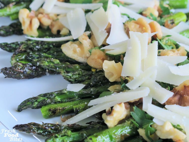 Lemon-Walnut Grilled Asparagus with Parmesan is so quick and easy to make and tastes so flavorful and fresh. It's perfect for any night you want to grill and need dinner on the table quickly. The lemon zest and fresh parsley add so much bright flavor, while the Parmesan cheese and crunchy toasted walnuts add decadence that makes this asparagus crave-worthy. Whether you make this for a weeknight dinner or a weekend dinner party, it will be a hit!