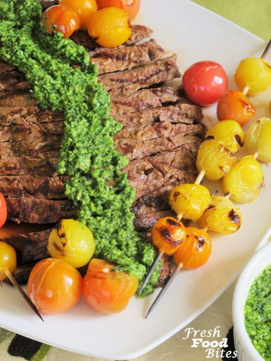 Beef flank steak tastes great when marinated and grilled. Make this Grilled Beef Flank Steak and Tomato Kabobs for an easy meal that is big on flavor and low on prep time. Marinate the beef earlier in the day so it's ready to grill just before dinnertime. Grilling the tomato kabobs takes just 5 minutes and elevates the sweet tomato flavor even more. Top it all off with Cilantro Pesto for a satisfying, healthy meal.