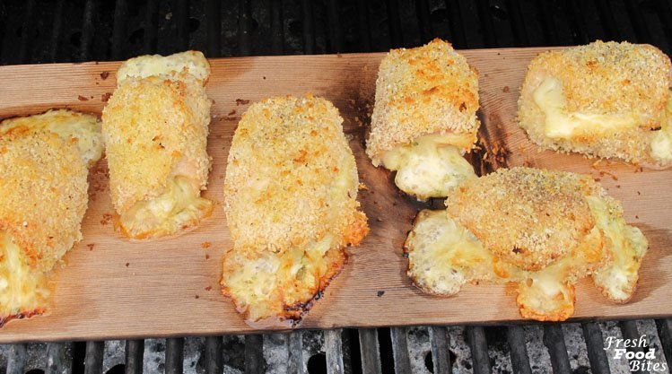 With a subtle smoky flavor coming from a cedar grilling plank, this sophisticated Plank-Smoked Chicken Cordon Bleu, that's stuffed with onion, mustard, thyme, ham and Swiss, will impress anyone at your table. Using a grilling plank means you can get a smoky flavor without the need for a smoker. Simply place the stuffed and rolled chicken on the soaked grilling plank and cook it on your standard gas or charcoal grill.