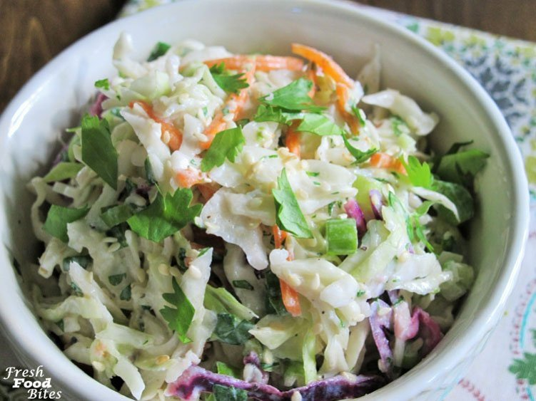 Bright, tangy fresh flavor abounds in this crunchy Cilantro-Lime Cabbage Coleslaw for a nice change-up from traditional creamy coleslaw. It's healthy, loaded with veggies, and pairs well with most any recipe you want to serve it with. From fish tacos, to grilled chicken, to shredded smoked pork sandwiches, this coleslaw fits in well for a truly fresh summer salad that is super low in calories.