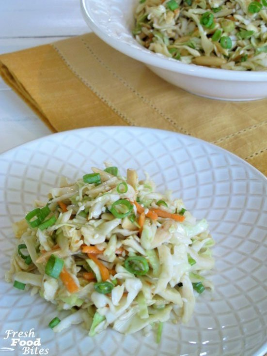 Crunchy, quick, and easy to make, this Ginger-Sesame Cabbage Slaw with Almonds is a crowd-pleasing Asian-inspired salad that is perfect for your next backyard barbecue or family gathering. Choose between a simple homemade dressing, or an even quicker version based on a purchased ginger-sesame dressing.