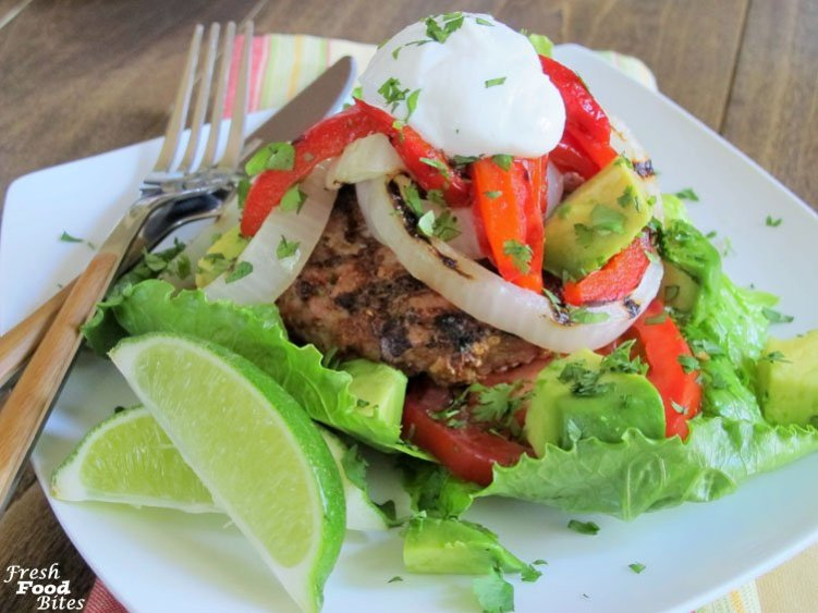 For a fun twist on turkey burgers and fajitas, try this Fajita Turkey Burger recipe. It combines the flavors and veggies of a fajita, with the convenience and simplicity of a turkey burger. Everything gets cooked on the grill, which keeps the heat and most of the mess out of your kitchen. By serving the meat and veggies on lettuce leaves rather than on the traditional tortilla, you can pile on the veggies and get a lot more beneficial nutrition at the same time!