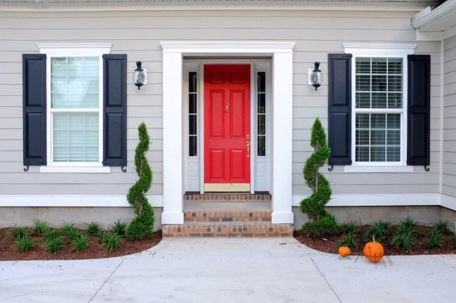 Neon red front door with mindful grey exterior