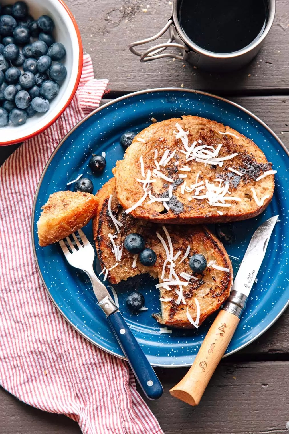 Vegan Coconut French Toast in a skillet on a camping table.