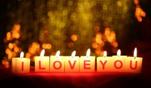 """Valentine's Day candles showing 'I LOVE YOU"""""""