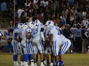 Madera in offensive huddle