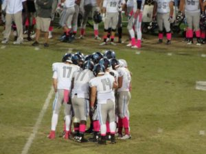 Clovis North Broncos in offensive huddle