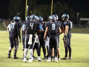 Clovis North in offensive huddle