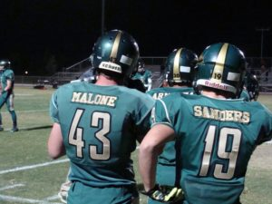 Wyatt Sanders and Kendall Malone getting ready for the game