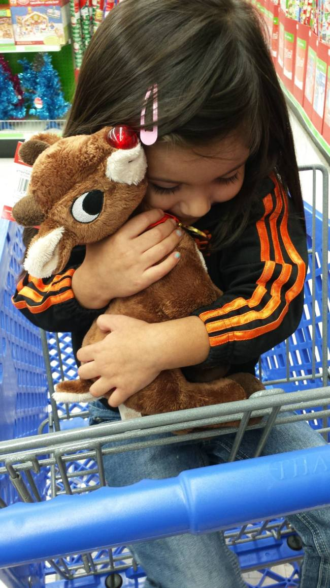 At Toys r Us, she saw Rudolph and just HAD to give him a hug!