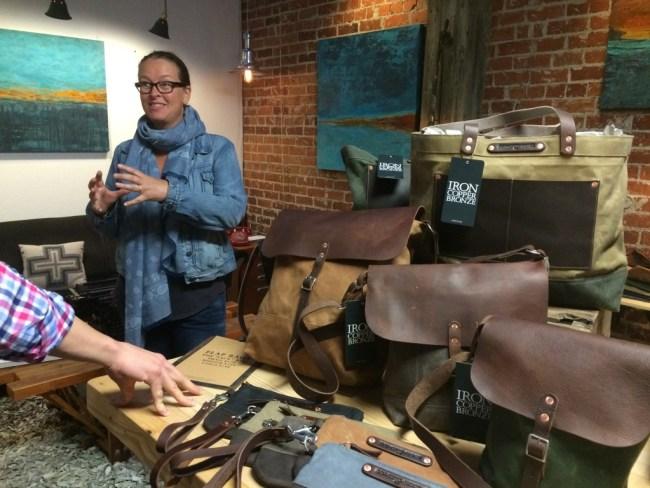 Artist Bibi Bielat talks to a visitor at Art Hop.