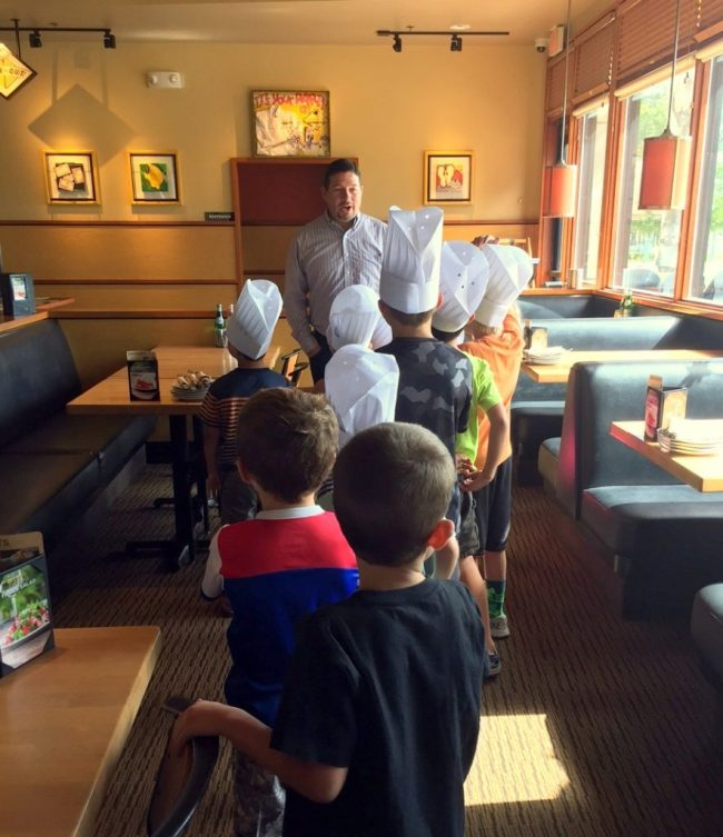 The kids begin their tour in the restaurant with Manager Kelly Baker