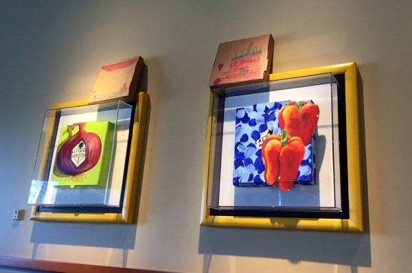 Past artwork adorns the walls