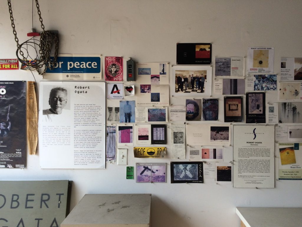 Flyers and clippings of Ogata's past shows hang on a wall in his downtown Fresno studio