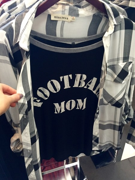 I've seen lots of moms at kids' sports games wearing similar tees, but I love the idea of pairing it with a trendy window-pane flannel.