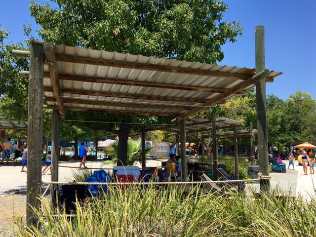 Shaded picnic areas surrounding Ohana Bay