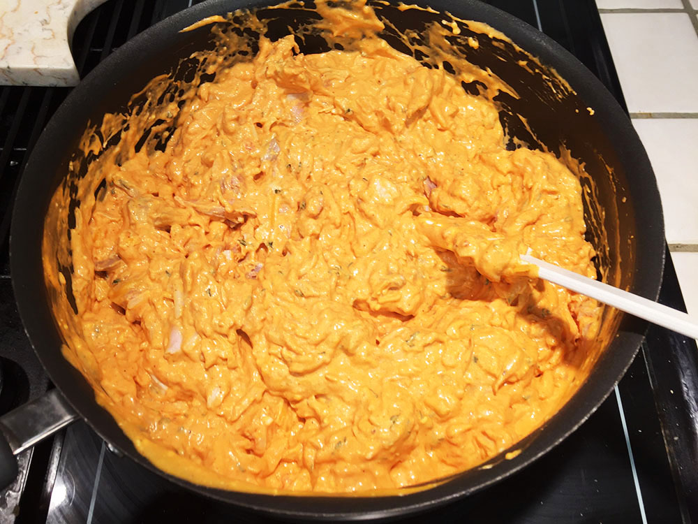 Blended sauce with chicken and cheese added