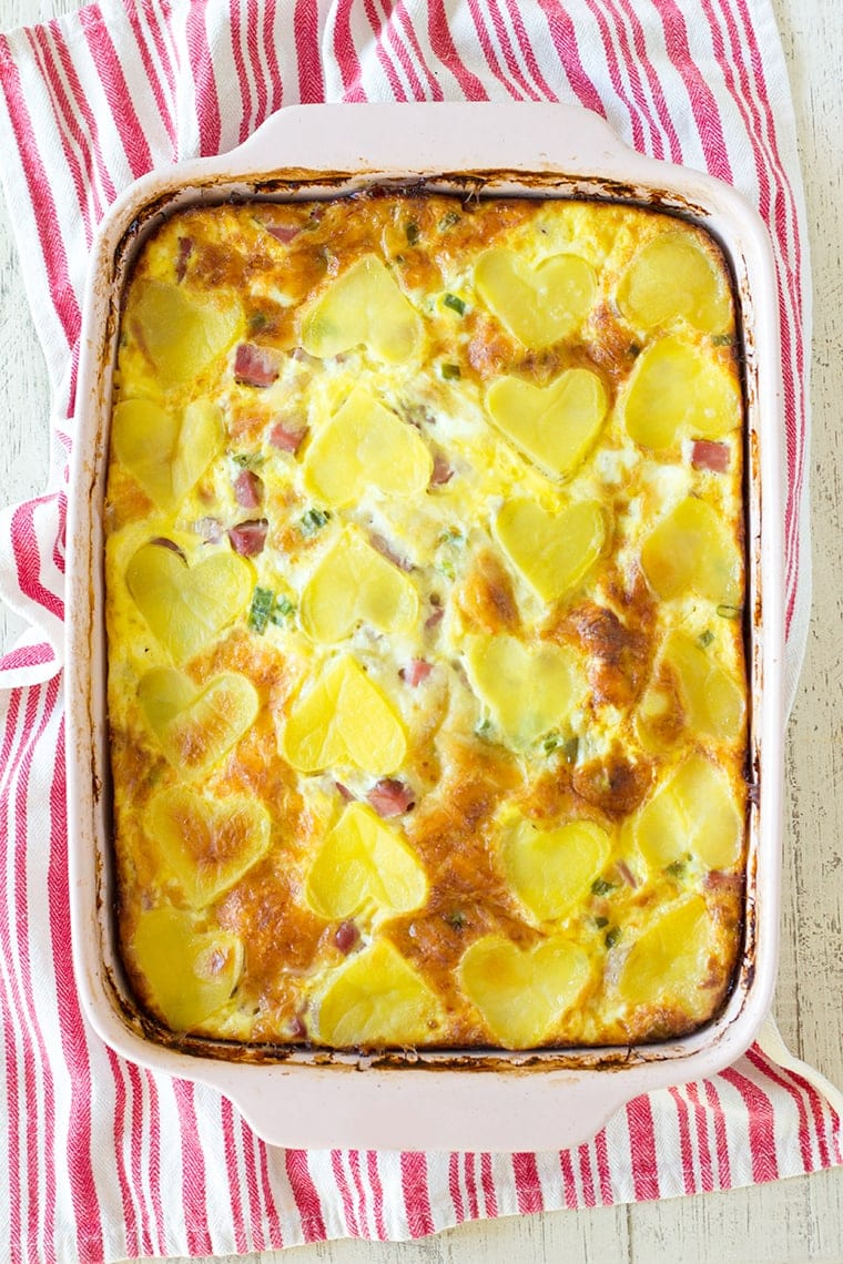 Valentine's Day Ham and Cheese Breakfast Casserole is the perfect way to show your family you love them on Valentine's Day morning. This egg, cheese, ham and potato casserole will fill their bellies and their hearts! #casserole #breakfast #breakfastcasserole #eggcasserole #potato #ham #valentinesday