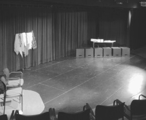 This is the typical setup for a Playback performance, and part of the ritual for Playback Theatre. Setting includes seating for the conductor (or MC), teller (an audience member), actors, and scarves and musical instruments/noisemakers.