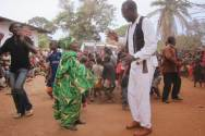Hudson taking part in a Congolese dance in Lweba with a member of the audience.