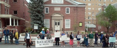 Friends gather for weekly peace vigil in front of Homewood Meeting in Baltimore, Md.