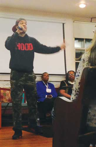 Jasiri X performing at the conference at Pendle Hill. Photo © Madeline Schaefer