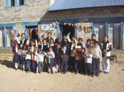 Basa school students with teacher in front of the school.