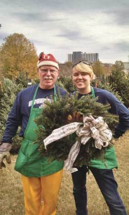 Terry and the author displaying a handmade wreath at a Christmas volunteering opportunity.