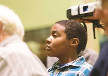 Youth audience member listening to Rev. William Barber II speak on Moral Mondays and working for justice at AFSC's Corporation Meeting in March. (c) James Wasserman.
