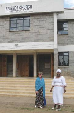 The author with Edith Wekesa, Quaker pastor, in front of Friends Church Ngong Road in Nairobi, Kenya.