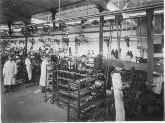 A vintage image of the sewing room in one of the C&J Clark factories. Via Wikimedia commons. C&J Clark archive.