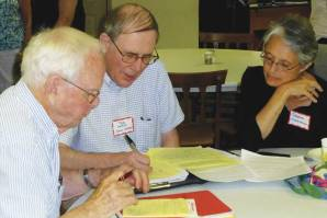 L to R: Lincoln Blake (Richmond First Friends), Tom Hamm (New Castle), and Stephanie Crumley-Effinger (West Richmond) working on the New Association of Friends' first epistle to Friends everywhere, August 2014.