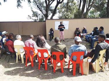 Facilitators training volunteer peace monitors.